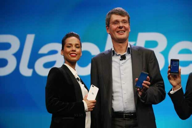 Beleagured BlackBerry president and CEO Thorsten Heins stands with the new BlackBerry global creative director, singer Alicia Keys at the BlackBerry 10 launch event in Jan. 2013. Can Keys help revitalize the brand? Mario Tama/Getty Images