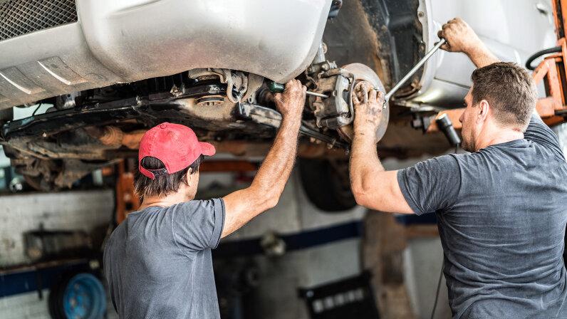 mechanics inspecting car