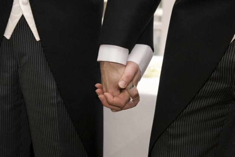 Newlywed couples can experience sticker shock over more than just the price of the tuxes (and everything else in the ceremony). Your combined income may put you in a new tax bracket. govicinity/iStockphoto/ThinkStock