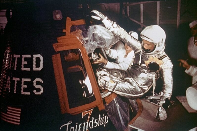 Astronaut John Glenn is loaded into the Friendship 7 capsule in preparation for flight on the Mercury Titan rocket in 1962. NASA/Getty Images