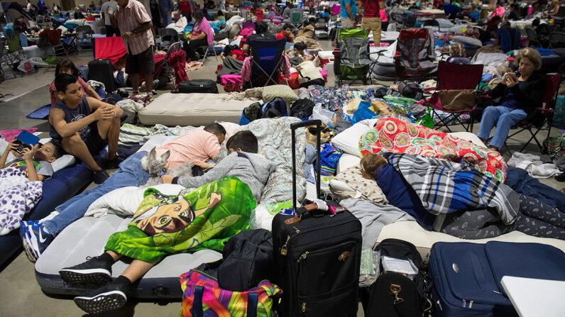 Hundreds shelter in place from Irma at the Miami-Dade County Fair Expo Center, which was converted into an emergency shelter, Sept. 8, 2017. Florida Gov. Rick Scott warned the state's 20 million residents should be prepared to evacuate to a safe location. SAUL LOEB/AFP/Getty Images