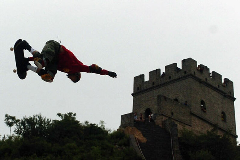 Danny Way jumps the Great Wall in Beijing, China – just one of our 10 amazing skateboarding feats. China Photos/Getty Images