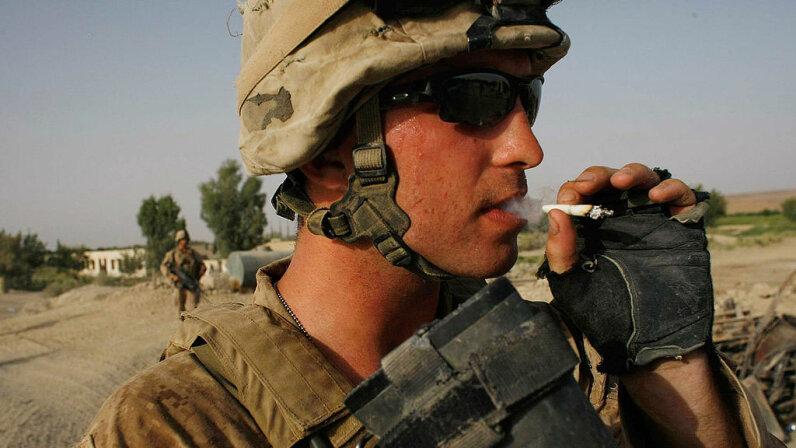U.S. soldier smokes a cigarette