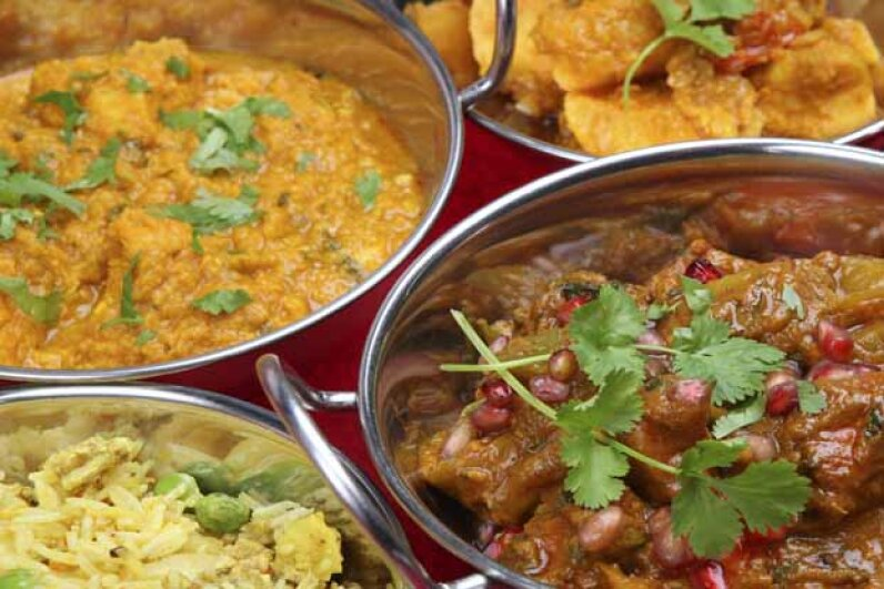 If you've eaten curry, chances are others can tell you did. The scent tends to ooze out of your pores. JoeGough/iStock/Thinkstock