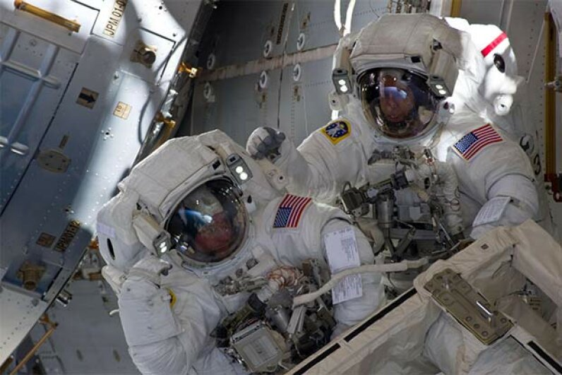 NASA astronauts Andrew Feustel (R) and Michael Fincke are pictured during the STS-134 mission's third spacewalk in 2011. Astronauts are carefully monitored for signs of mental stress while on space missions. NASA via Getty Images