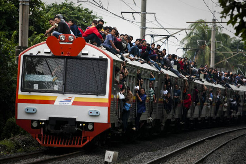An extreme version of train surfing in Jakarta, Indonesia as hundreds ride the roof due to overcrowded trains and lack of funds to buy tickets. Ulet Ifansasti/Getty Images