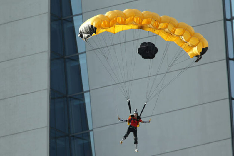 A BASE jumper steers his parachute after launching off the sky park at Marina Bay Sands in Singapore. Lionel Ng/Getty Images
