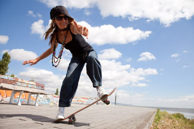 Some cities make it a crime to do skateboard tricks on public streets. Hemera/Thinkstock
