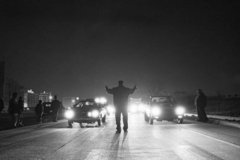 Drag racers often risk jail time, fines, and license suspension -- not to mention killing themselves or onlookers with their actions. Matthew Wakem/Workbook Stock/Getty Images