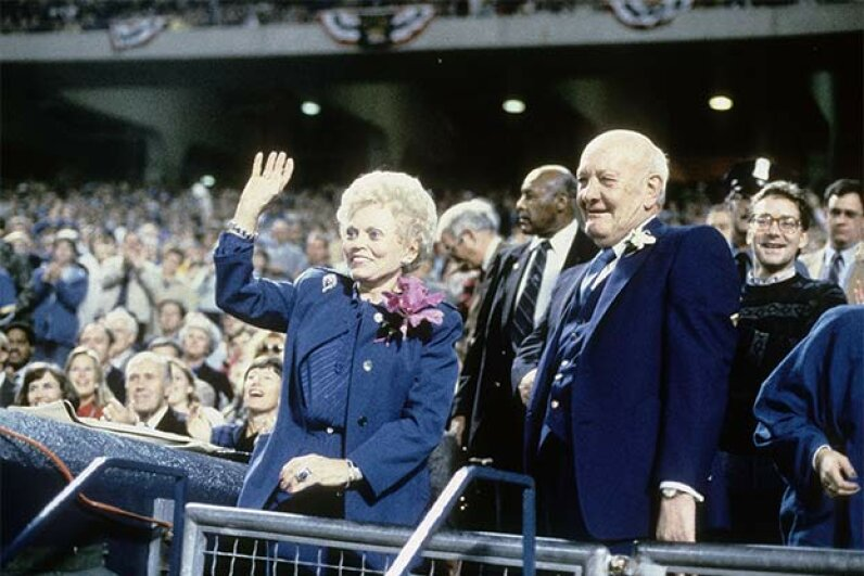 The owner of the Kansas City Royals, Ewing Kauffman, and his wife Muriel waved to the fans prior to the start of a World Series game in 1985. Later that year, ballplayers began suspecting team owners of collusion to keep salaries down. Focus on Sport/Getty Images