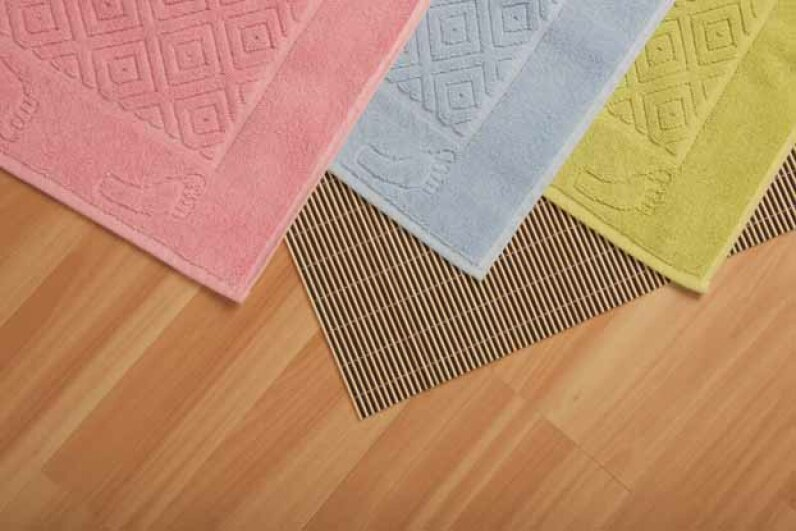 Think of the many feet that have stepped on your dorm's bathroom mat. Then get it to a washing machine -- pronto. iStockphoto/Thinkstock