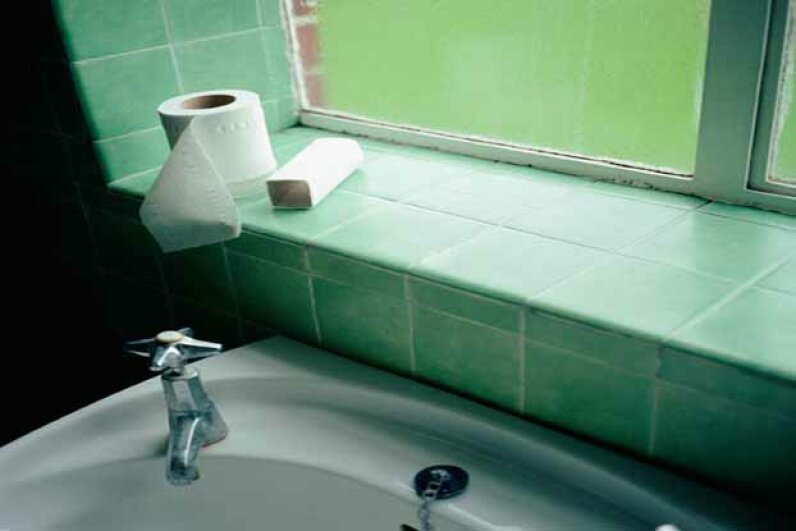 You'd be amazed at the gunk that lives behind the bathroom sink. Image Source/Thinkstock