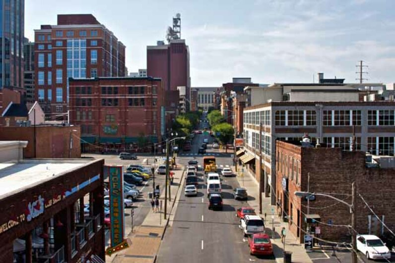 Though this street in downtown Nashville looks quiet, commuters in Music City spend more time in their cars than anywhere else in the U.S.A. Matthew D White/Peter Arnold/Getty Images