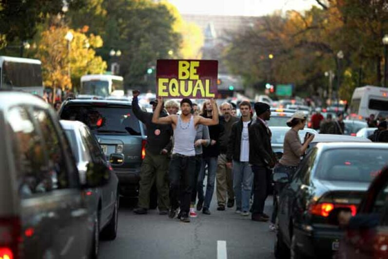 Demonstrators from the Occupy DC movement shut down rush hour traffic as they march through downtown Washington. Chip Somodevilla/Getty Images