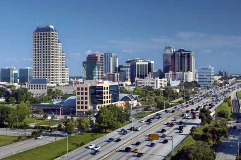 "The Orlando skyline rises above the traffic on Interstate 4, a highway that runs east to west through central Florida. The area surrounding the highway is often referred to as the ""I-4 Corridor."" John Coletti/Photographer's Choice/Getty Images"