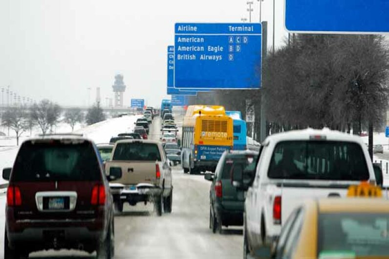 Heavy traffic fills the road at Dallas/Fort Worth International Airport after snowfall in Feb. 2011. Tom Pennington/Getty Images