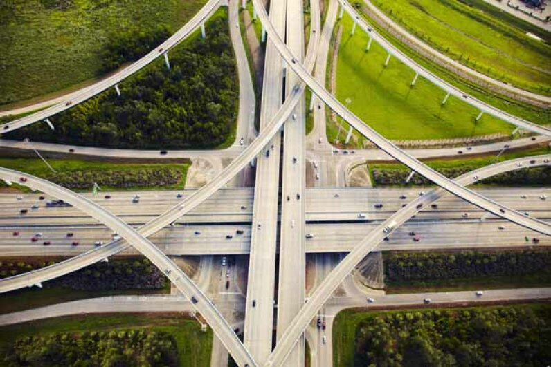 An aerial view of traffic and overpasses in Houston which spans a massive 600 square miles. Thomas Northcut/Lifesize/Getty Images