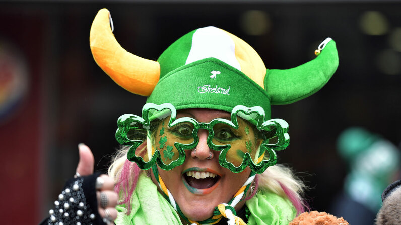 St. Patrick's Day parade, wearing shamrock-shaped glasses,