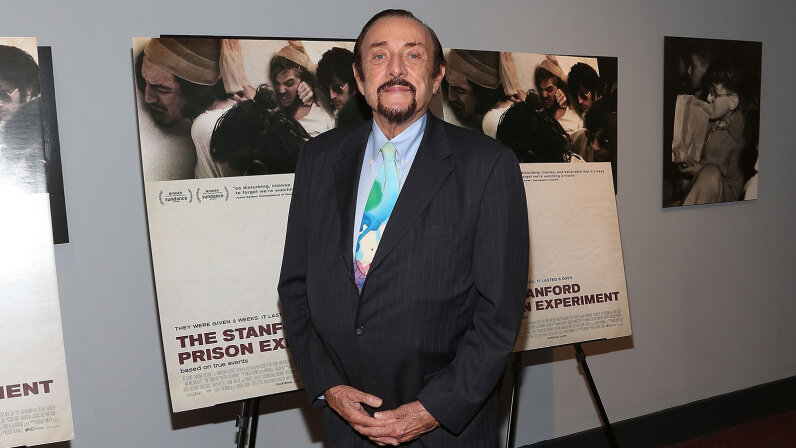 Zimbardo poses in front of posters for the 2015 movie  Taylor Hill/FilmMagic/Getty Images
