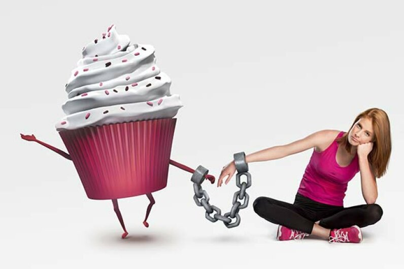 Chained to cupcakes? Sugar can be as addictive as drugs. Tijana87/iStock/Thinkstock