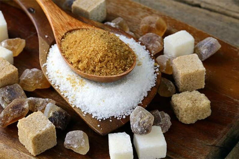 Raw sugar looks like it should be healthier than refined white sugar but raw sugar has only traces of minerals (white has none). Both have the same number of calories. olgakr/iStock/Thinkstock