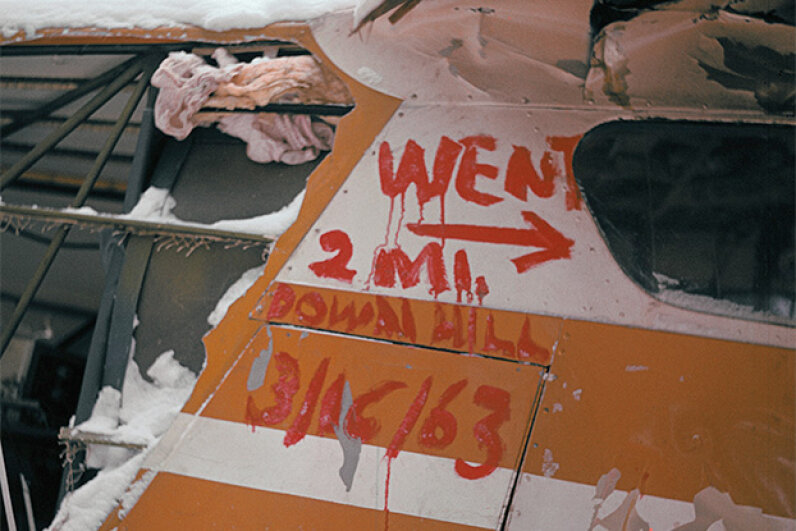 This distress sign was painted on the side of the plane that Helen Klaben and Ralph Flores went down in. They survived in the Arctic for more than 40 days without food. © Bettmann/CORBIS