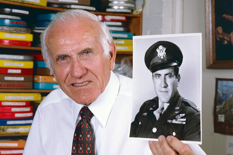 This 1985 picture shows Louis Zamperini holding a photo of himself taken during World War II. Bob Riha, Jr./Getty Images