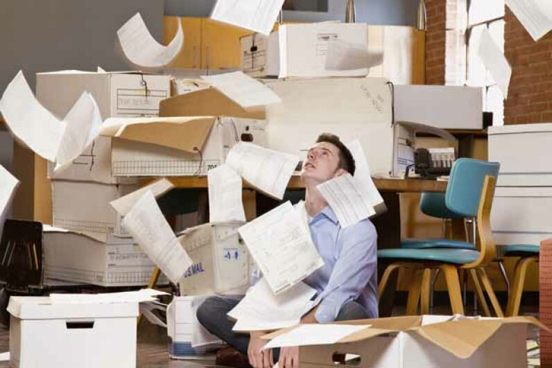 "As you struggle with the overflowing paperwork, you may have a number of tax questions. We answer the most common ones. See more ""Tax Day Crazy"" pictures. DreamPictures/Digital Vision/Getty Images"