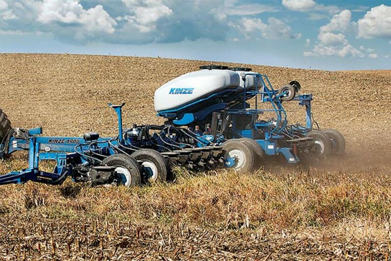 This multi-hybrid planter allows farmers to change seed type right in the middle of planting. Kinze Manufacturing.