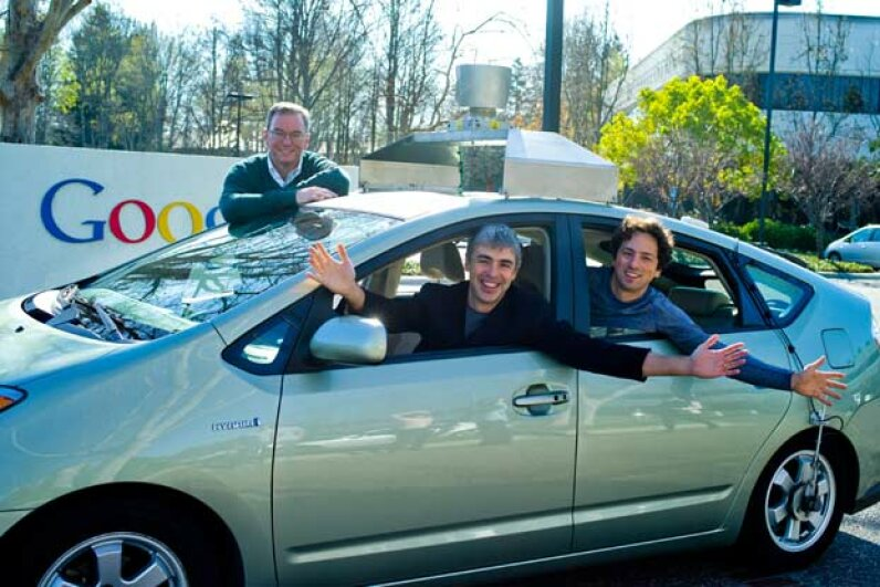 Larry Page, Sergey Brin and Eric Schmidt show off one of Google's driverless cars. Courtesy Google