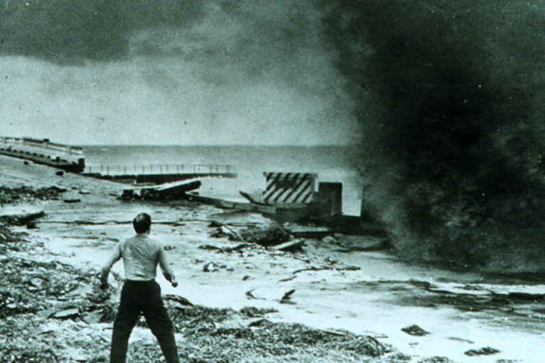 A startled man gets ready to run after a hurricane-driven wave smashes into a seawall in 1947. See more storm pictures. NOAA