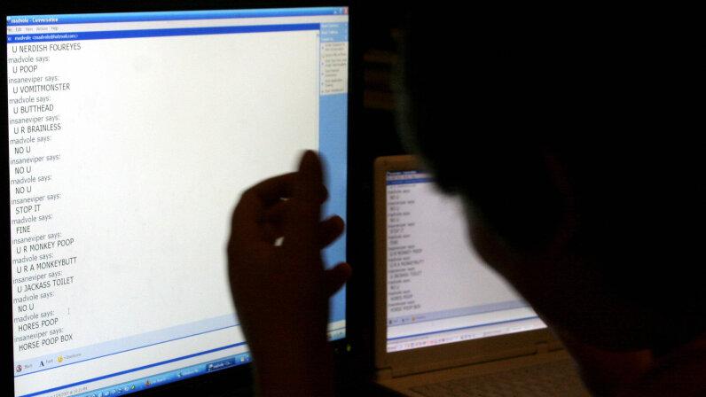 boy staring at laptop screen