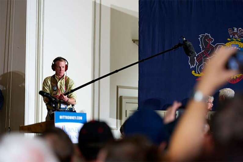 A boom operator records crowd sound as Republican presidential candidate Mitt Romney greets supporters in Pennsylvania in 2012. Strong shoulders are a must for this job. © Mark Makela/Corbis