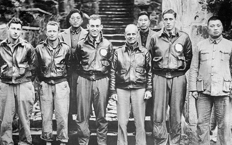 Lt. Col. Jimmy Doolittle (fifth from left), his bombing crew and some Chinese friends are pictured here in China, after the airmen bailed out following Doolittle's raid on Japan, on April 1, 1942. Bettmann/Getty Images