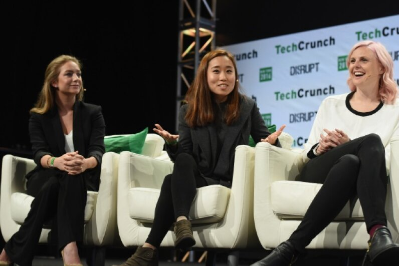 Left to right, co-founder and CEO of Bumble Whitney Wolfe, co-founder and COO of Coffee Meets Bagel Dawoon Kang and Founder of Her Robyn Exton speak onstage during TechCrunch Disrupt NY 2016.   Noam Galai/Getty Images for TechCrunch