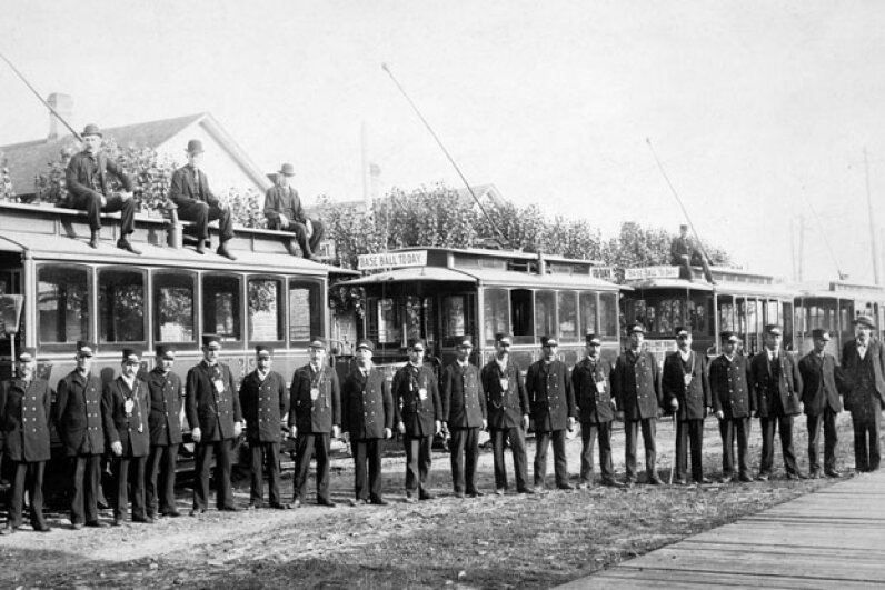 Manistee's history is the central focus of its tourist industry. These streetcar drivers, pictured in 1910, would likely still find some parts of town familiar. © Kirn Vintage Stock/Corbis