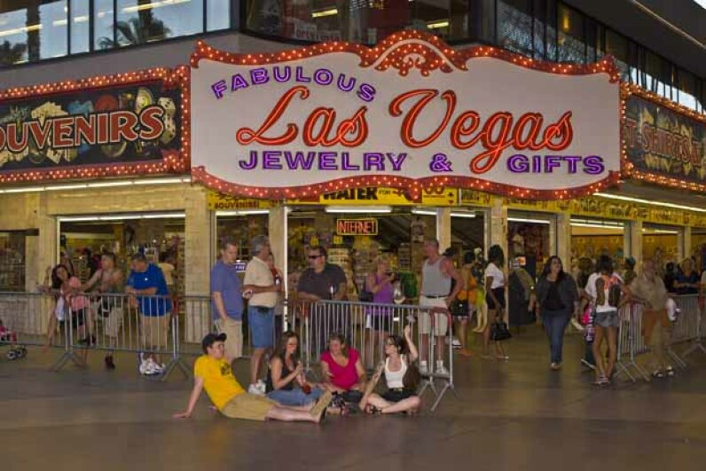 A crowd of people hang out at the Fremont Street Experience in Las Vegas. George Rose/Getty Images