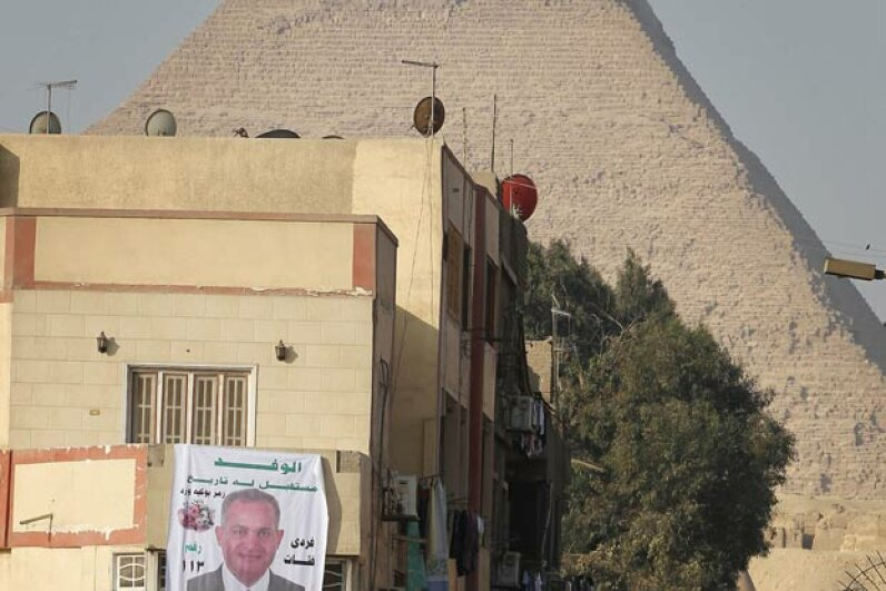 Somehow, you didn't think the buildings would be so close to the Pyramids in Giza, Egypt. Peter Macdiarmid/Getty Images