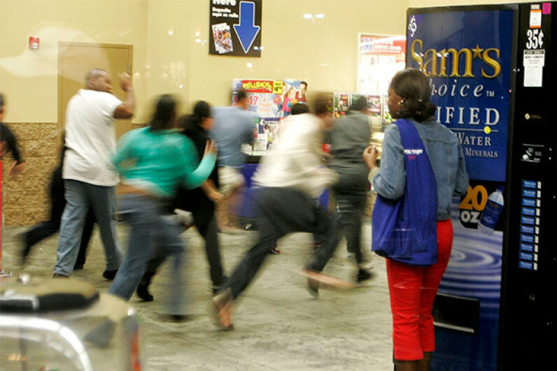 Crowds rush into a Miami Wal-Mart store as the doors open at 5 a.m., to scoop up deals on Black Friday, 2005. Buying some hot toys was likely part of the excitement. Carlo Allegri/Getty Images