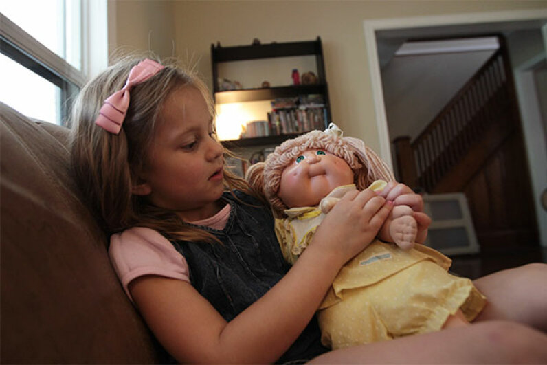 Four-year-old Megan Fedorchuk plays with her mom's vintage Cabbage Patch doll at the family home in 2011. Rene Johnston/Toronto Star via Getty Images