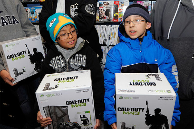 Angel Alvarez (left) and his cousin Isiah Alvarez hold their limited edition 'Call of Duty: Modern Warfare 3' Xbox 360 consoles as they wait for midnight during a launch event for the highly anticipated video game in 2011. Ethan Miller/Getty Images