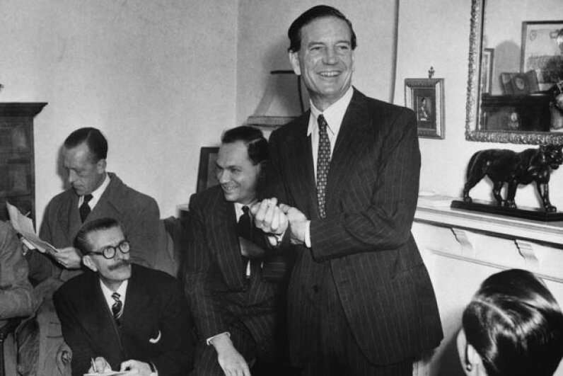 Kim Philby jokes with newsmen at his mother's home during a 1955 press conference after being formally cleared of tipping off Guy Burgess and Donald Maclean that British intelligence was on to them. Philby later resigned from MI6, but agents interrogated him about this again in 1963. As they closed in, he escaped to Russia. © Bettmann/CORBIS
