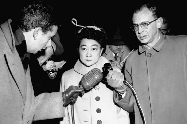 Iva Toguri d'Aquino looks overwhelmed while being interviewed by journalists before her trial. She had told them she was Tokyo Rose in hopes of collecting an interview fee, little realizing this would lead to her arrest and imprisonment. © CORBIS