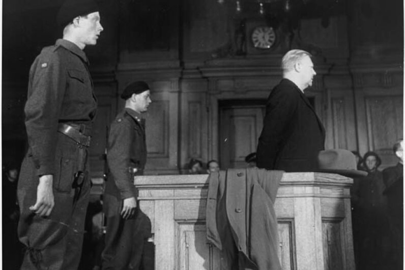 Surrounded by soldiers, a pale-faced Vidkun Quisling begins the legal battle for his life in a crowded court room in Oslo. He lost and was executed by firing squad for treason. © Hulton-Deutsch Collection/CORBIS