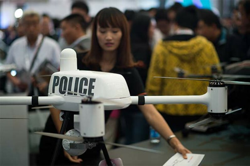 A drone used by the police is displayed at the 2014 China International Industry Fair in Shanghai in 2014. Drones are used in all kinds of industries. JOHANNES EISELE/AFP/Getty Images