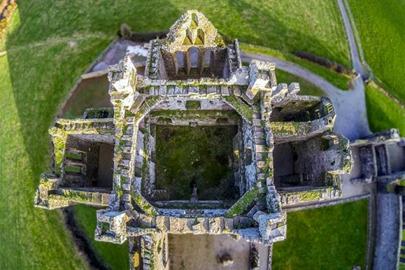A drone camera took this aerial shot of a castle in Ireland. www.thrumyeyesbyjamie.com/Getty Images