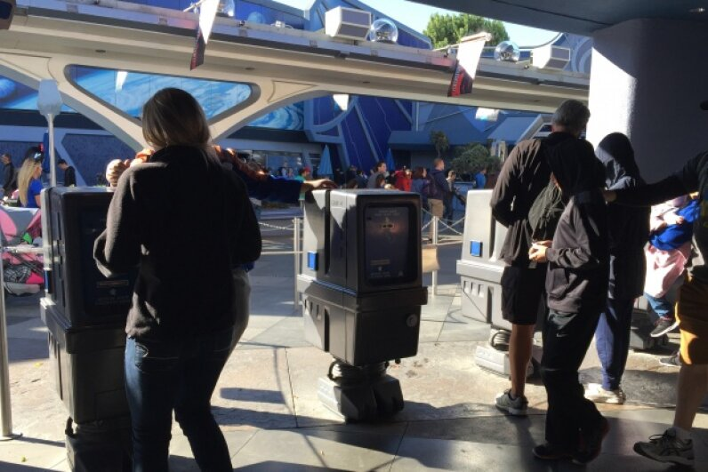 GNK droids are SO unappreciated that they're relegated to issuing Fastpasses in Disneyland.  Photo by HowStuffWorks