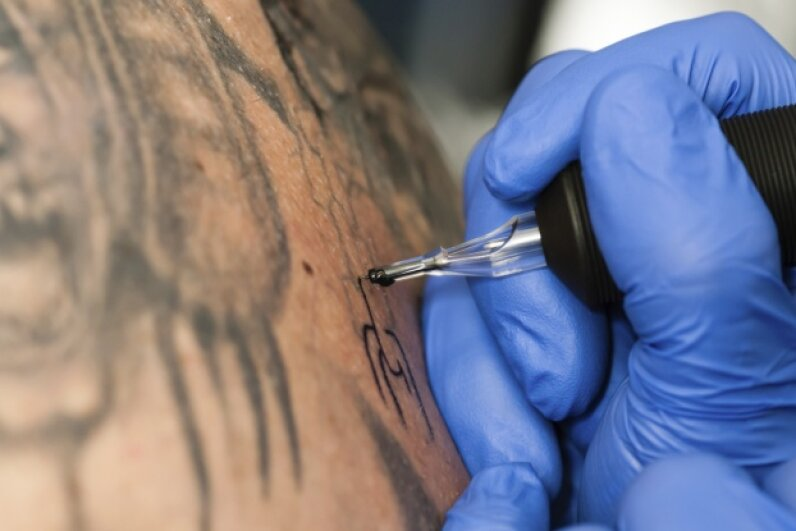 In a roundabout way, Edison had a hand in that ink. He also sported his own tattoo: A 1911 policy issued by the Mutual Life Insurance Company reports that Edison had five dots in a pattern resembling the face of a die tattooed on his left forearm.  RvDam/iStock/Thinkstock