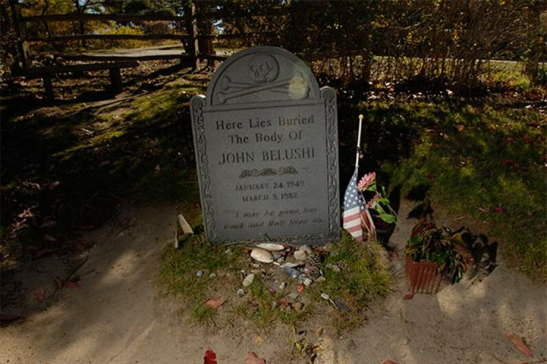 John Belushi was originally buried beneath this headstone but vandalism from zealous fans caused the family to move his body a few feet away. © Neville Elder/Corbis