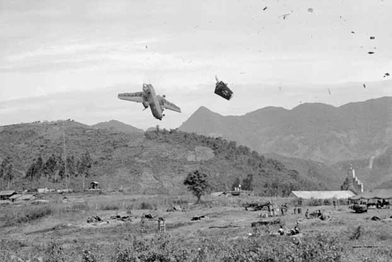 Split seconds after a U.S. Caribou transport plane had been hit by American artillery, UPI photographer Miromichi Mine recorded this remarkable picture as the plane plummeted to earth at Ha Phan, Vietnam. The three crew members were killed. © Bettmann/CORBIS